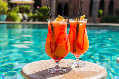 Morocco「Fruity cocktails floating on swimming pool」:スマホ壁紙(5)
