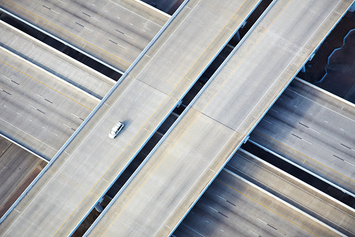 Multiple Lane Highway「Aerial shot of one car on freeway」:スマホ壁紙(0)