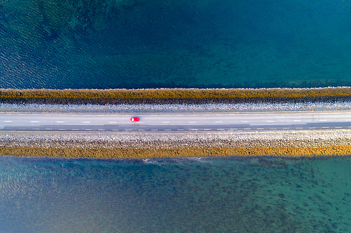 Causeway「Aerial Shot of Coastal Road with Red Car in Iceland」:スマホ壁紙(12)