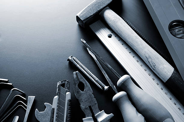 Group of many different construction tools, blue toned, copy space:スマホ壁紙(壁紙.com)