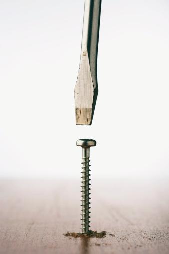 Sawdust「Flathead screwdriver above screw sticking out of wood, close-up」:スマホ壁紙(16)