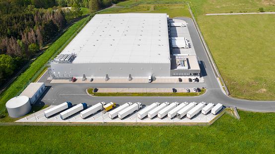 Parking Lot「Loading bay, truck parking lot, industrial building, logistics - aerial view」:スマホ壁紙(4)