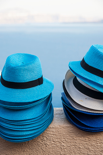 Stack Rock「Blue hats in a pile on a wall with a view of the water; Oia, Santorini, Greece」:スマホ壁紙(19)
