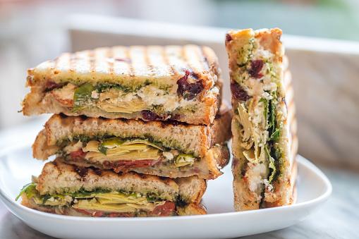 Sandwich「Stacked Vegetarian Sandwiches of Arugula, Artichoke, Sun Dried Tomato, Pesto」:スマホ壁紙(4)