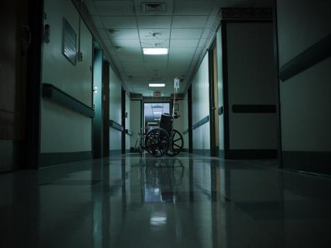 Dark「Empty wheelchair and intravenous drip in hospital corridor」:スマホ壁紙(10)