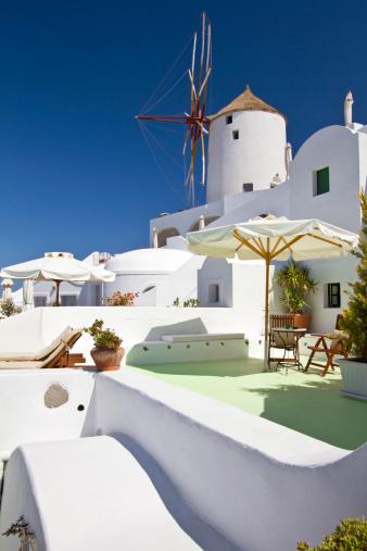 Summer Resort「Luxury resort in Santorini with windmill in Greece」:スマホ壁紙(10)