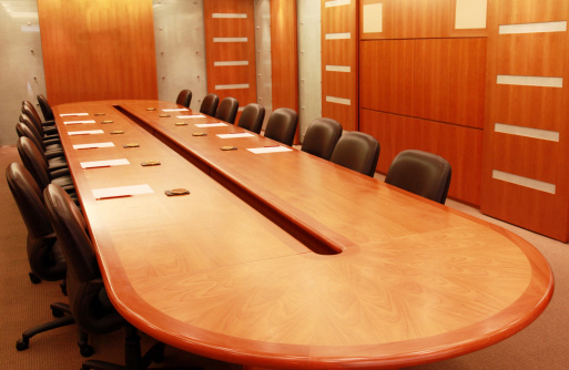 Wood Paneling「Conference room with large wooden table and leather chairs」:スマホ壁紙(2)