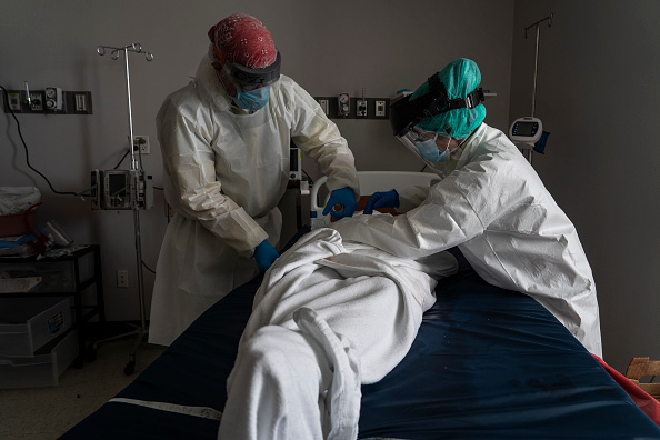 Death「Texas Hospitals Cope With State's Surge In Coronavirus Cases」:写真・画像(9)[壁紙.com]