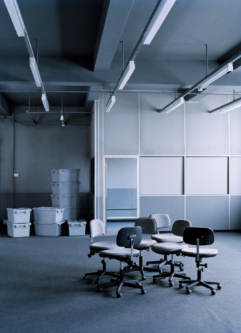 Unemployment「Group of office chairs in empty office space, crates in background」:スマホ壁紙(17)