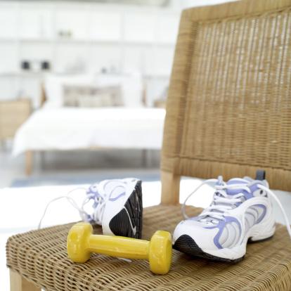 スポーツ用品「a dumbbell and a pair of sneakers lying on a wicker chair」:スマホ壁紙(2)