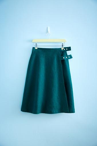 Skirt「Green skirt hanging on wall」:スマホ壁紙(6)
