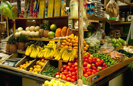 野菜・フルーツ「Colorful display of various fruits, vegetables and other products at a market」:スマホ壁紙(12)