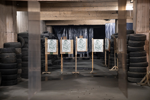 Sports Target「Boards with male likeness as targets in an indoor shooting range」:スマホ壁紙(3)