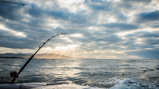 Fishing「Fishing poles on boat over ocean waves」:スマホ壁紙(2)