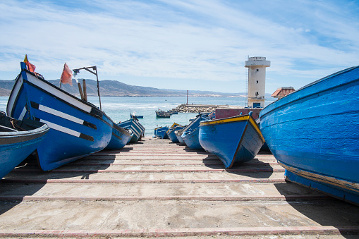 Morocco「Blue boats docked on boat ramp」:スマホ壁紙(5)