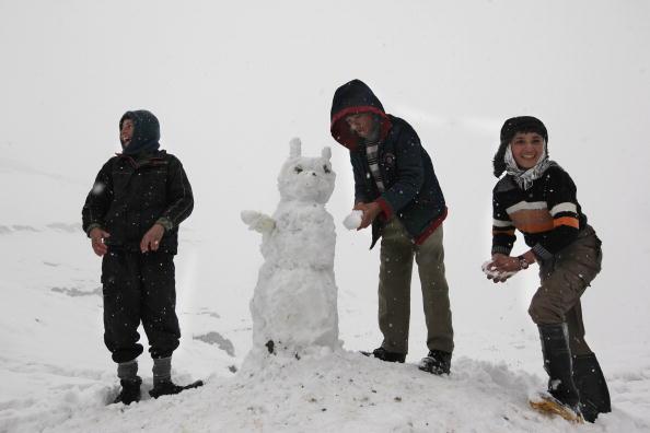 雪だるま「Snowstorm Slows Down Life In Kabul」:写真・画像(8)[壁紙.com]