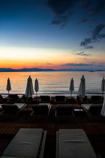 トウヒ「Board walk, parasols and deck chairs at Sunrise, Corfu, Greece」:スマホ壁紙(12)