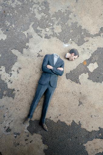 Nerd「Headless businessman figurine laying on cocrete」:スマホ壁紙(6)