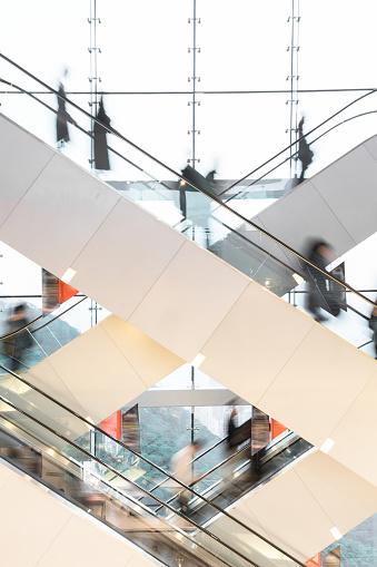 Escalator「Modern Escalator with blurred people」:スマホ壁紙(3)