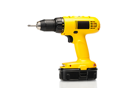 Hand Tool「Cordless yellow power drill isolated on a white background」:スマホ壁紙(17)