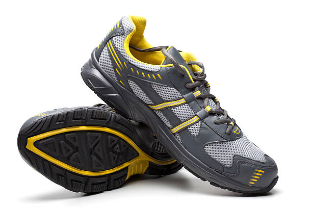 Grey and yellow sport shoes stacked on each other:スマホ壁紙(壁紙.com)