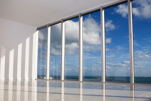 Miami「Blue sky viewed through windows in modern apartment」:スマホ壁紙(8)