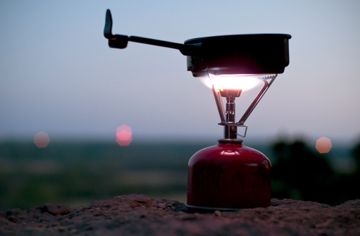 Camping Stove「A camp stove illuminates the dusk evening on top of a bluff at Dynosaur State Park near Glen Rose, Texas.」:スマホ壁紙(7)