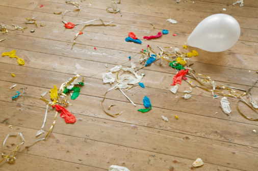 The Morning After「Burst balloons and party streamers on wooden floor」:スマホ壁紙(12)