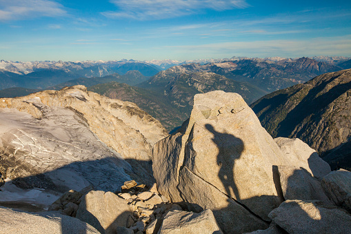 Unrecognizable Person「The shadow of a backpacker is projected on a large granite rock high in the rocky mountains of British Columbia, Canada.」:スマホ壁紙(14)