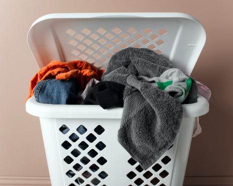 Dirty「Laundry basket filled with washing, close-up」:スマホ壁紙(0)