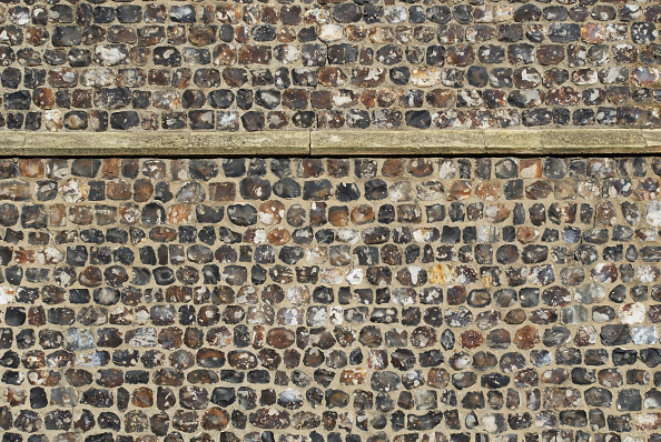 Finance and Economy「Pebble stonework on the exterior walls of a church, Norwich, UK」:写真・画像(11)[壁紙.com]