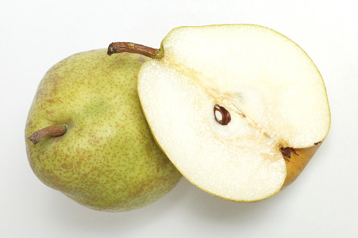白梨「Pear sliced in half, white background」:スマホ壁紙(8)