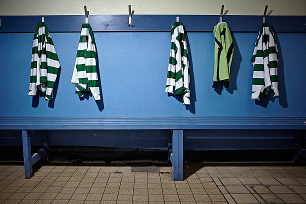A empty changing room with football strips:スマホ壁紙(壁紙.com)