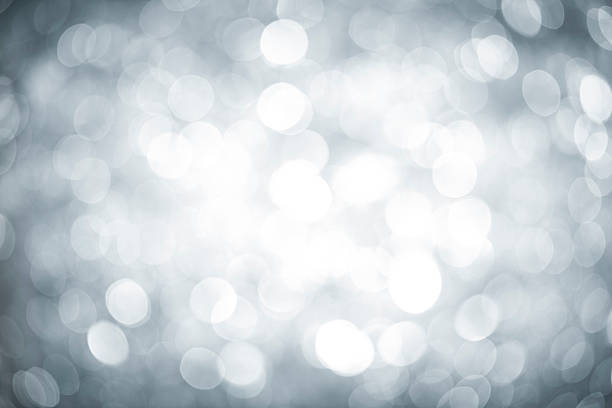 Blurred silver sparkles with darker corners and bright center:スマホ壁紙(壁紙.com)