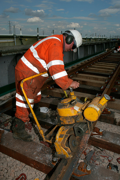 Grinder - Industrial Equipment「A railway worker grinds down a weld on newly relaid track near Peterborough. May 2005」:写真・画像(10)[壁紙.com]