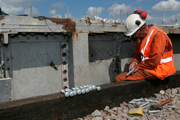 Finance and Economy「Railway worker inspects bolts whilst renovating a bridge near to Peterborough. May 2005」:写真・画像(7)[壁紙.com]