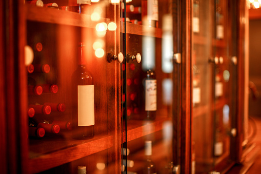 Rack「Wine cabinet with glass doors with wine bottles stacked inside」:スマホ壁紙(6)