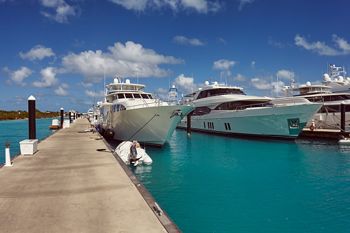 cloud「Luxury motor yachts tied up in a Caribbean marina, surrounded by azure tropical sea.」:スマホ壁紙(1)