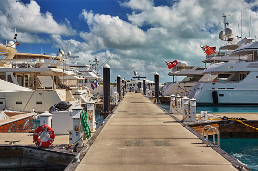 cloud「Luxury motor yachts tied up in a Caribbean marina, surrounded by azure tropical sea.」:スマホ壁紙(3)