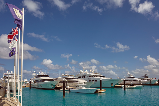 cloud「Luxury motor yachts tied up in a Caribbean marina, surrounded by azure tropical sea.」:スマホ壁紙(17)