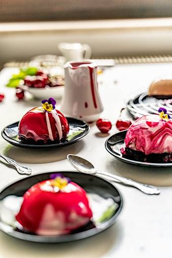 Preparing Food「Homemade Dome Desserts with Edible Wild Pansy Flower Decoration on Kitchen Table - stock photo」:スマホ壁紙(3)