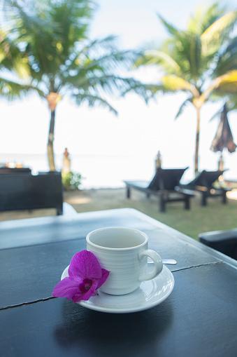 Resort「Beachside coffee cup with blossom」:スマホ壁紙(0)