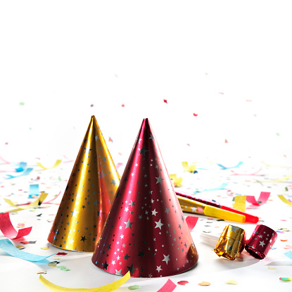 New Year「Party hats, whistles, horns, confetti isolated on white, studio shot」:スマホ壁紙(11)