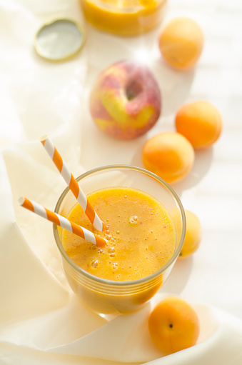 杏「Peach apricot smoothie in glass, drinking straws」:スマホ壁紙(5)