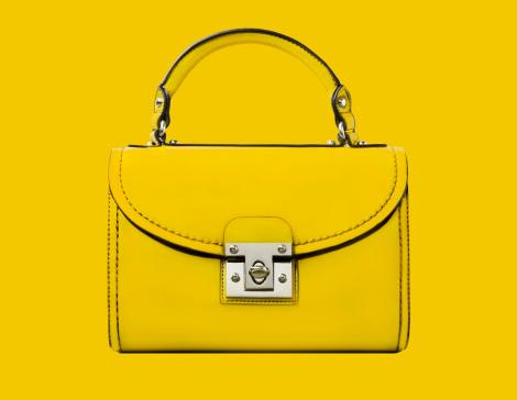 カラー背景「A yellow handbag against a yellow background」:スマホ壁紙(6)