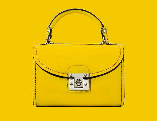 A yellow handbag against a yellow background:スマホ壁紙(壁紙.com)