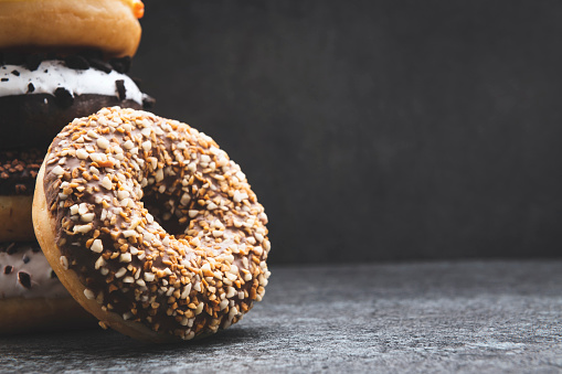 Doughnut「Donuts with sprinkles on the rustic dark background」:スマホ壁紙(17)