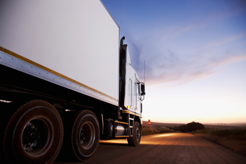 South Africa「Semi-truck driving on dirt road」:スマホ壁紙(17)