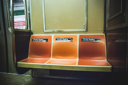 Disability「Empty Seats on Subway Car with Priority Seating Stickers, New York City, USA」:スマホ壁紙(7)
