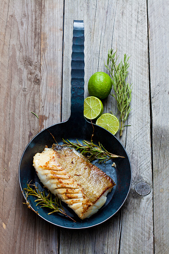 Cod「Cast-iron frying pan with piece of fried Norwegian codfish and twigs of rosmary」:スマホ壁紙(18)